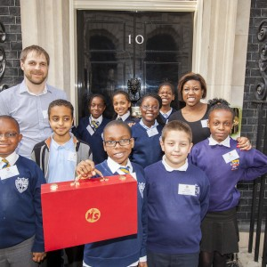 After-school club members with their tutors in front of 10 Downing Street (photo: Tom Oldham)