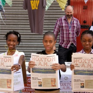Young journalists hold up their newspaper Hoxton AM