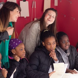 Volunteers and young writers in Poetry Takeaway stall (photo: Alistair Hall)