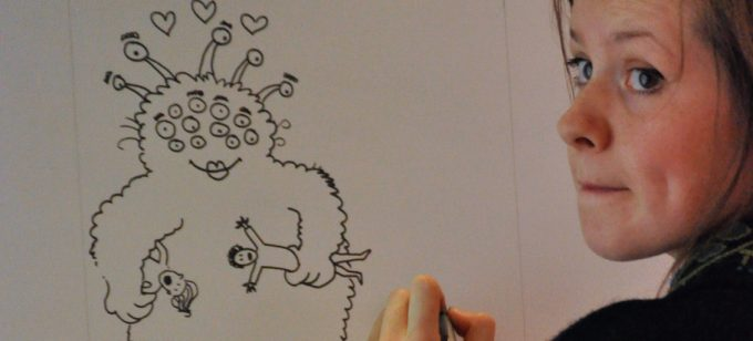 Illustrators drawing picture of a monster.
