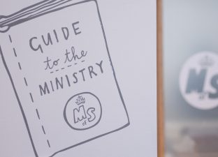 'Guide to the Ministry' illustration on wall