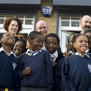 Founders with school children in front of shop (photo: Miriam Douglas)