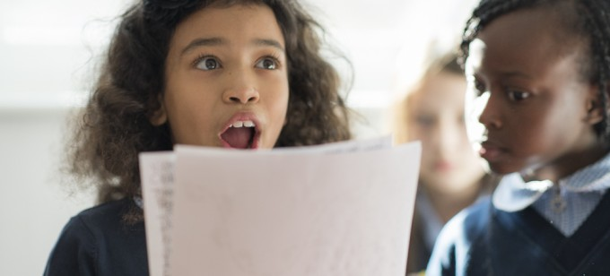 young student reads out her writing