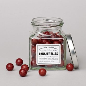 A glass jar of aniseed balls created especially for banshees