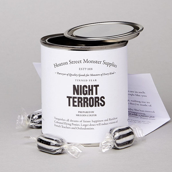 A white tin with sweets and a story called 'Night Terrors'