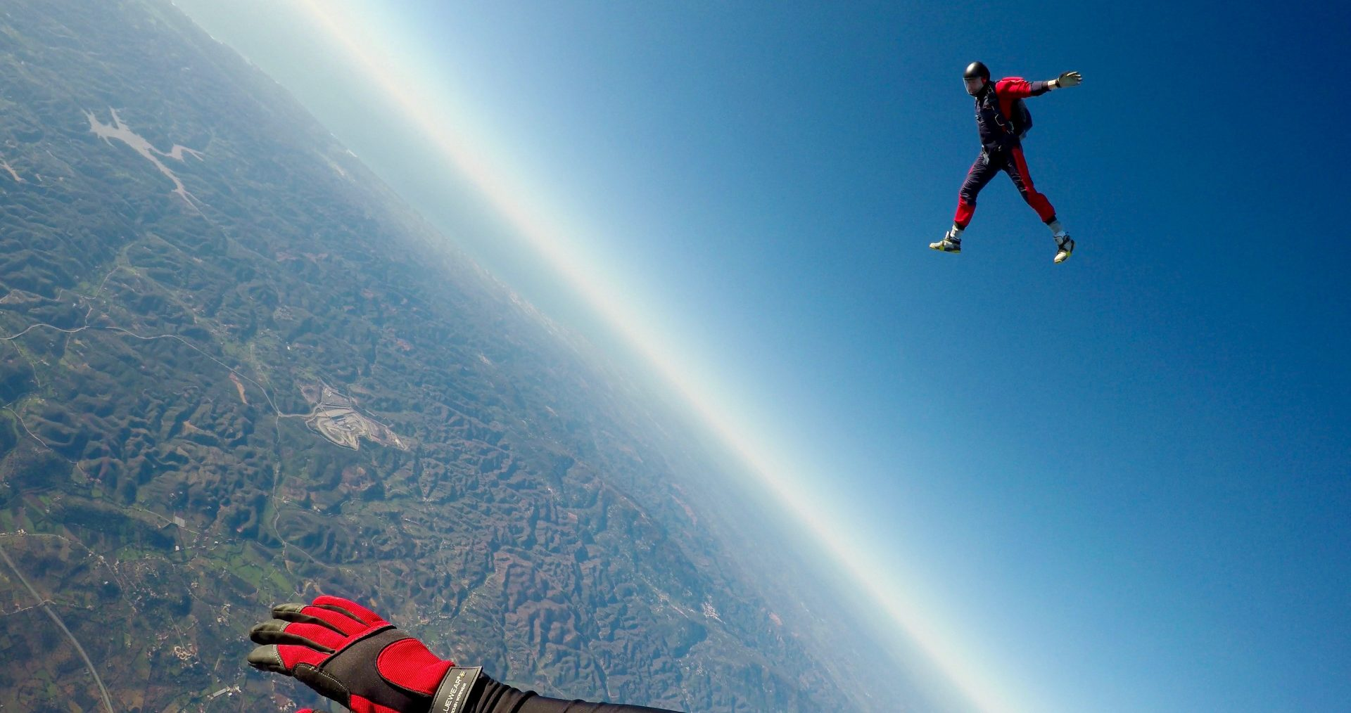Man jumps out of plane in a skydive